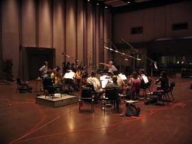 Michael Brandeburg conducts the orchestra during a recording session at LucasFilm Sound and Recording Studios in Marin County, California
